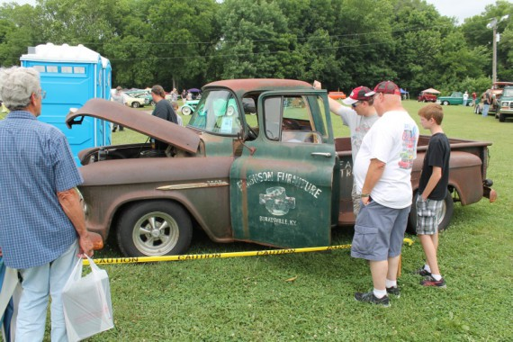 Old Chevy pickup truck drawing a crowd.
