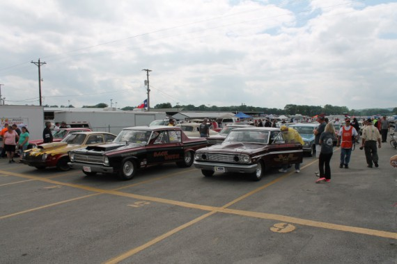 The old cars were lined up for their turn at the start line.