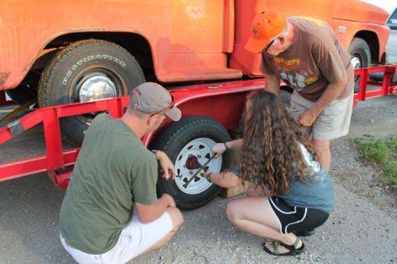 Mallory changing a tire.