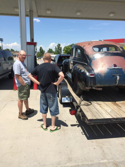 KK talking with the owner of an old car.