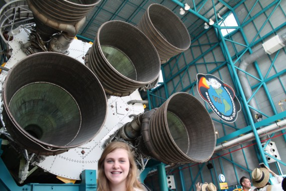 Marissa and the tail end of the Saturn V rocket.