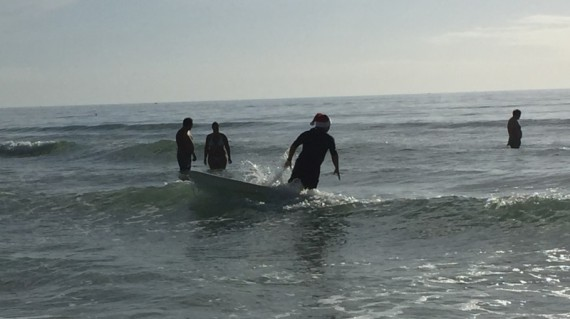 Surfer with a Santa Hat