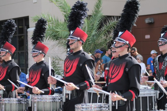 Miles in his last parade. I loved the palm tree in the background.
