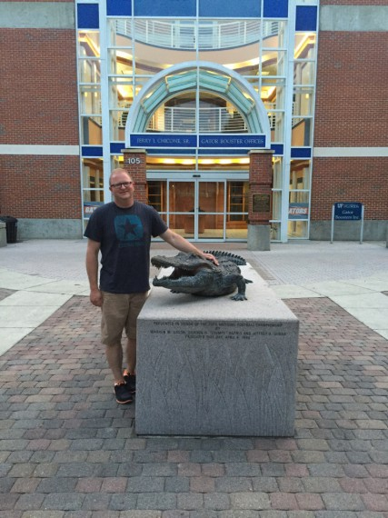 Scott with a Gator outside the stadium.