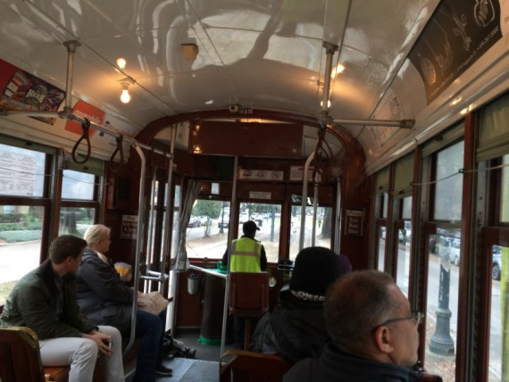 Riding in a New Orleans streetcar.