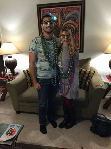 Miles and Peyton with masks and beads.