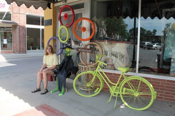 Marissa with a bicycle-themed storefront