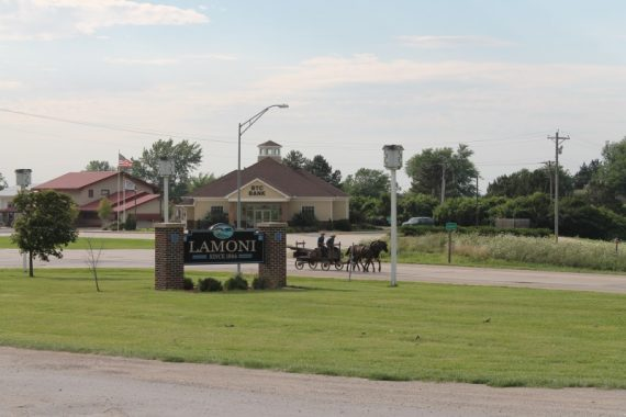 On cue, an Amish buggy drove past the Lamoni sign